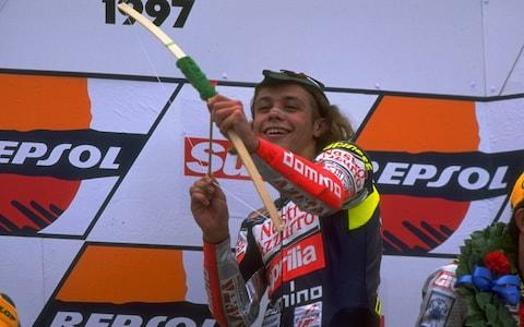 17 Aug 1997: Valentino Rossi of Italy celebrates victory at the British Motorcycle Grand Prix at Donington Park in England. Rossi went on to win the 125cc world title. \\ Mandatory Credit: Mike Cooper /Allsport - Credit: Mike Cooper/Allsport