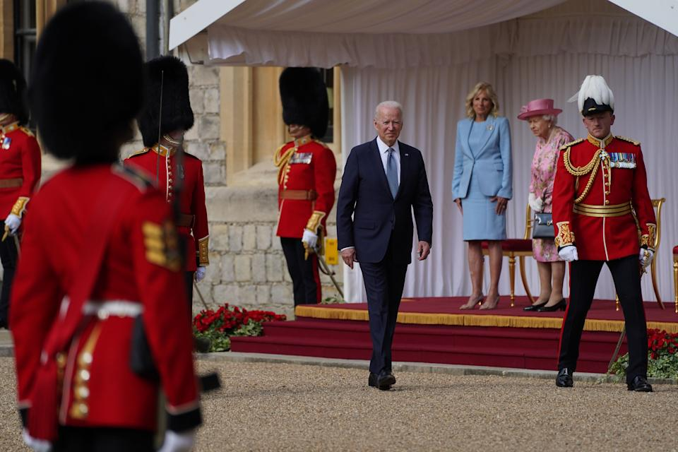 US President Joe Biden inspects a Guard of Honour during a visit to Windsor Castle in Berkshire to meet Queen Elizabeth II. Picture date: Sunday June 13, 2021.