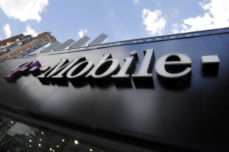 FILE - This Wednesday, Oct. 14, 2015, file photo shows a T-Mobile store in New York. A federal indictment accuses Huawei of stealing trade secrets from T-Mobile, in the form of a robot designed to automatically test phones for problems. (AP Photo/Richard Drew, File)