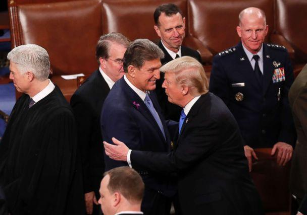 PHOTO: President Donald Trump hugs Democratic Senator from West Virginia Joe Manchin as he departs after delivering his State of the Union address to a joint session of the U.S. Congress on Capitol Hill in Washington, Jan. 30, 2018. (Jonathan Ernst/Reuters)