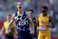 FILE - Clayton Murphy celebrates after winning the men's 800-meter run at the U.S. Olympic Track and Field Trials in Eugene, Ore., in this Monday, June 21, 2021, file photo. The connection that might best illustrate the tangled web Nike weaves with its running partners is the 23-year sponsorship deal worth a reported $500 million it cut with USA Track and Field back in 2014.(AP Photo/Ashley Landis, File)