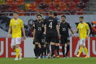 Germany's Serge Gnabry, second right, celebrates with teammates after scoring the opening goal during the World Cup 2022 group J qualifying soccer match between Romania and Germany at the National Arena stadium in Bucharest, Romania, Sunday, March 28, 2021. (AP Photo/Vadim Ghirda)