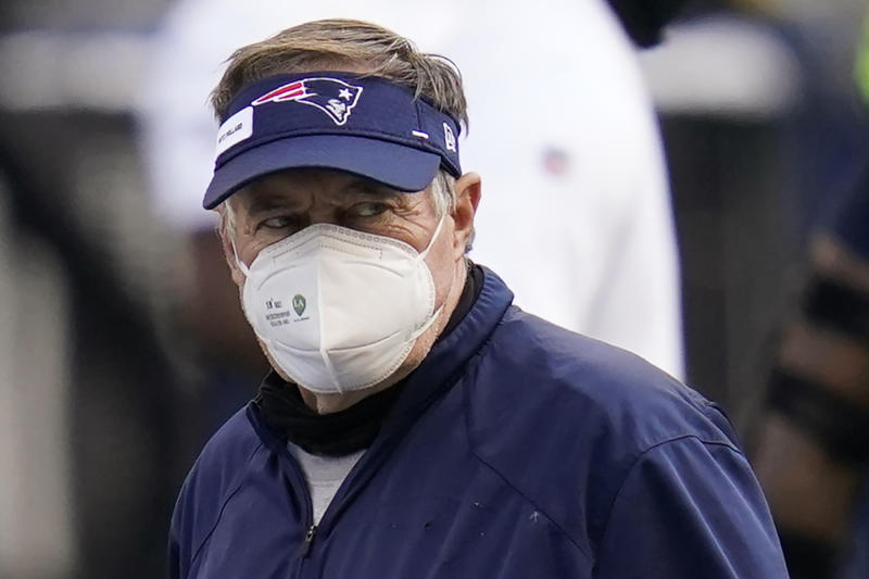 New England Patriots head coach Bill Belichick wears a mask as he walks on the field before an NFL football game against the Seattle Seahawks, Sunday, Sept. 20, 2020, in Seattle. (AP Photo/Elaine Thompson)