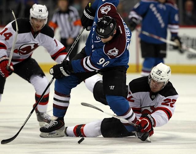 Colorado Avalanche center Ryan O'Reilly, center, is tripped by New Jersey Devils defenseman Eric Gelinaas, right, as Devils center Adam Henrique covers in the second period of an NHL hockey game in Denver, Thursday, Jan. 16, 2014. (AP Photo/David Zalubowski)