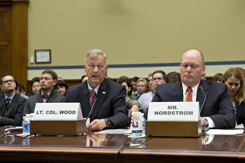 Lt. Col. Andrew Wood, left, a Utah National Guard Army Green Beret who was the top security official at the consulate in Libya, and Eric Nordstrom, right, a regional security officer with the State Department, testify on Capitol Hill in Washington, Wednesday, Oct. 10, 2012, before the House Oversight and Government Reform Committee hearing investigating the Sept. 11, 2012 attack on the American consulate in Benghazi, Libya, that resulted in the death of U.S. Ambassador Christopher Stevens and other Americans. (AP Photo/J. Scott Applewhite)