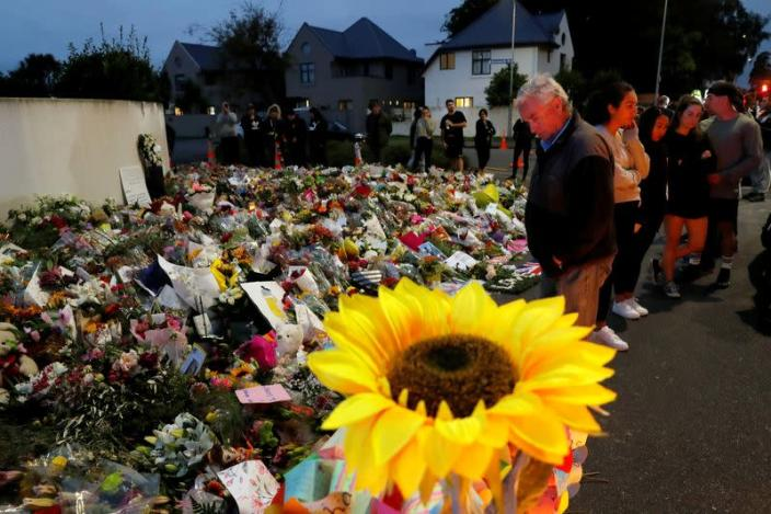 FILE PHOTO: People visit a memorial site for victims of Friday's shooting, in front of the Masjid Al Noor mosque in Christchurch