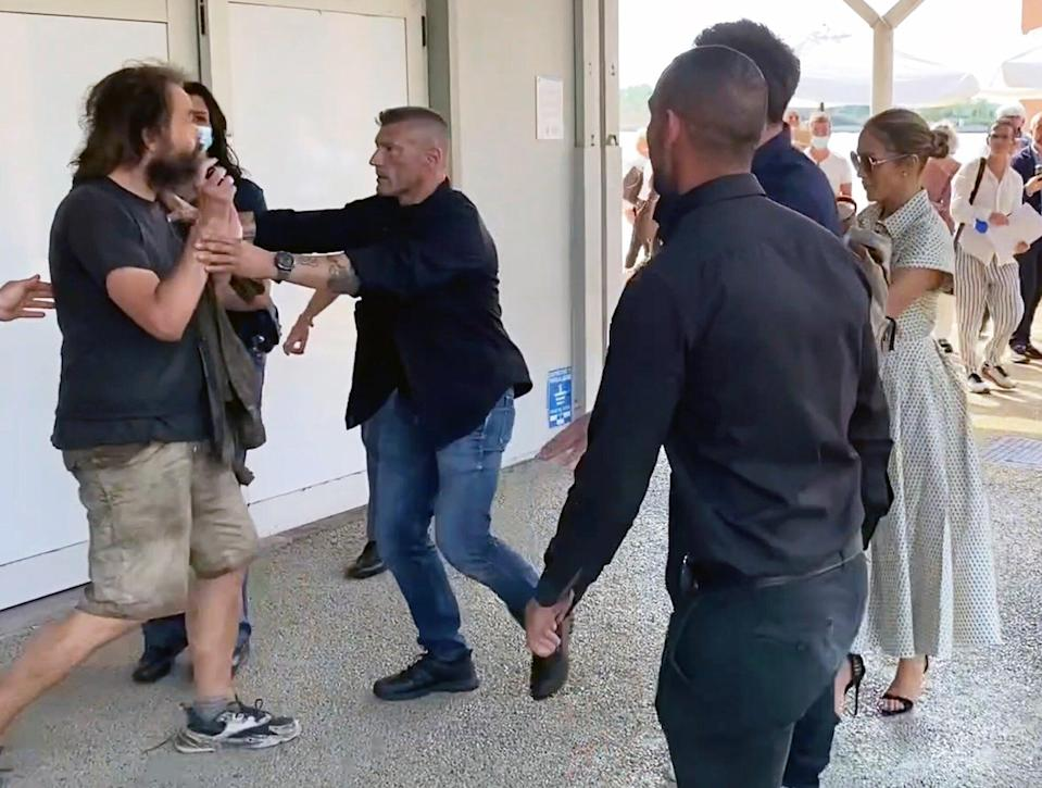 09/11/2021 EXCLUSIVE: Ben Affleck pushes away a fan who tries to take a photo with Jlo in Venice. The 49 year old American actor who is attending the Venice film festival with Lopez was spotted pushing away a male at an airport as a fan attempted to take a selfie with the couple.
