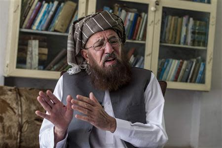 Maulana Sami-ul Haq, a Pakistani cleric and head of Darul Uloom Haqqania talks during an interview with Reuters, at his house in Akora Khattak