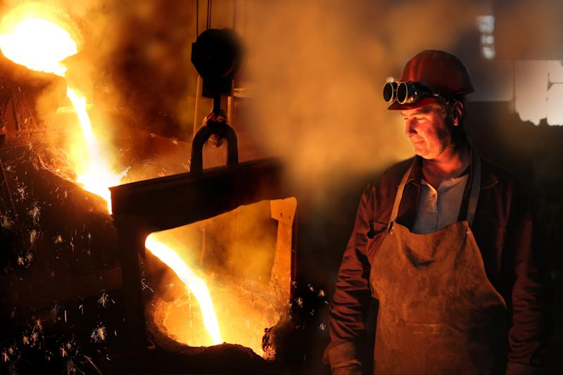 A man standing in front of pouring steel