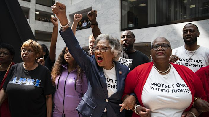 Representative Joyce Beatty, a Democrat from Ohio, center, leads a group of activists through the Hart Senate Office Building during a protest about voting rights on Capitol Hill in Washington, D.C., U.S., on Thursday, July 15, 2021. (Photographer: Al Drago/Bloomberg via Getty Images)