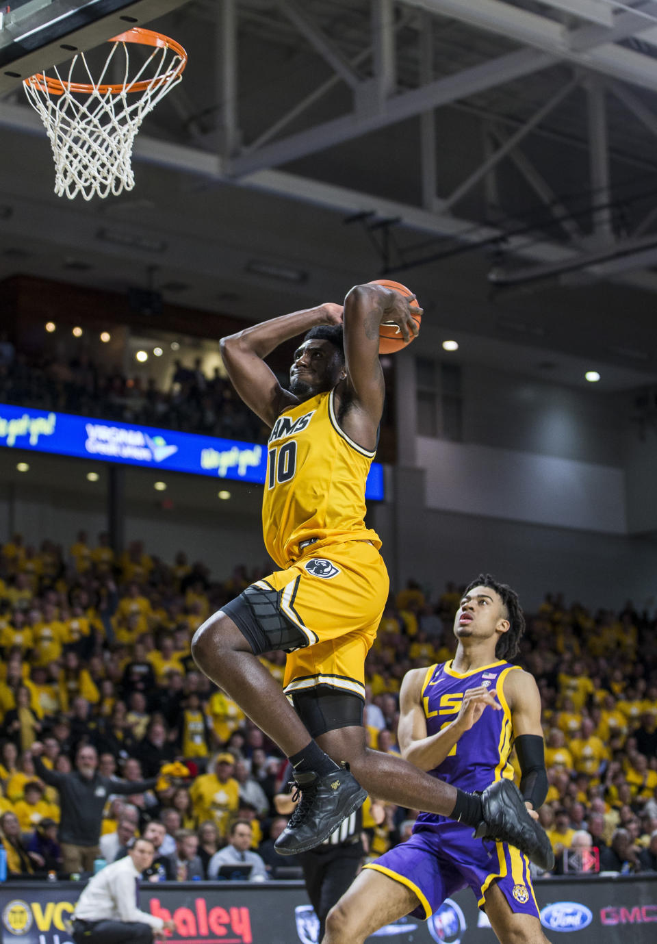 Virginia Commonwealth guard Vince Williams (10) dunks during the first half of an NCAA college basketball game against LSU in Richmond, Va., Wednesday, Nov. 13, 2019. (AP Photo/Zach Gibson)