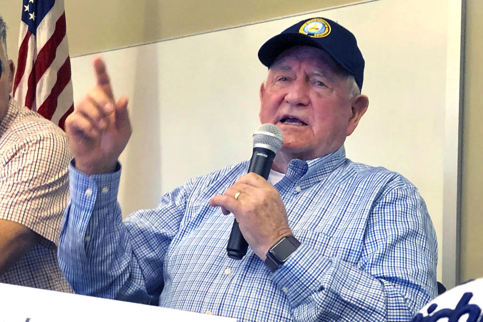 U.S. Agriculture Secretary Sonny Perdue speaks at an Ag Policy Summit during a visit Wednesday, Aug. 28, 2019 to Decatur, Ill. Perdue has sought to assuage farmers' fears of financial problems after China halted purchases of U.S. farm products in an escalating trade war. (AP Photo/John O'Connor)