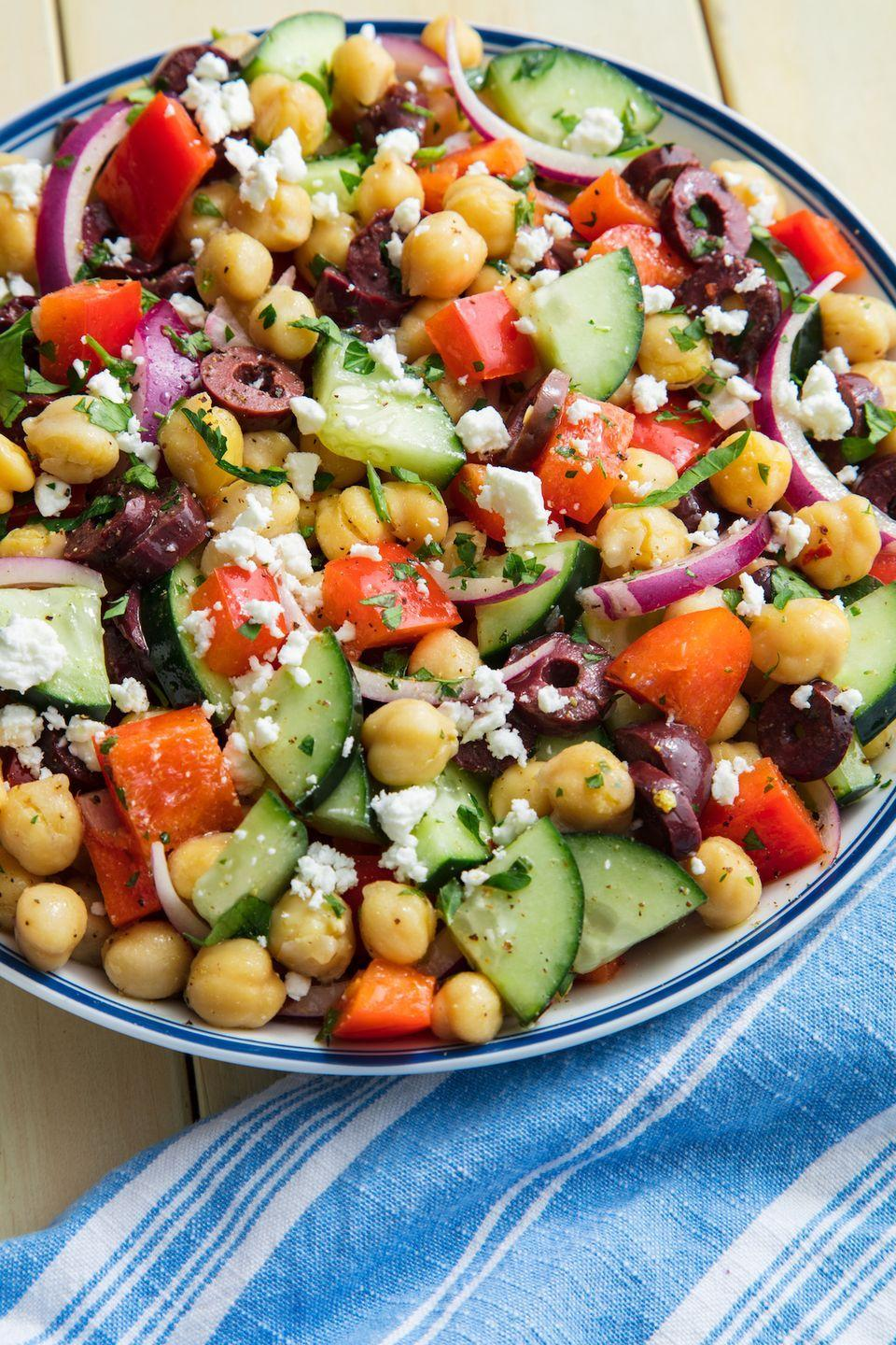 """<p>Thanks to the chickpeas, this salad will keep you full for hours. It's satisfying in a way that leafy greens never could be. Sorry we're not sorry, kale.</p><p>Get the recipe from <a href=""""https://www.delish.com/cooking/recipe-ideas/a19885314/mediterranean-chickpea-salad-recipe/"""" rel=""""nofollow noopener"""" target=""""_blank"""" data-ylk=""""slk:Delish"""" class=""""link rapid-noclick-resp"""">Delish</a>.</p>"""