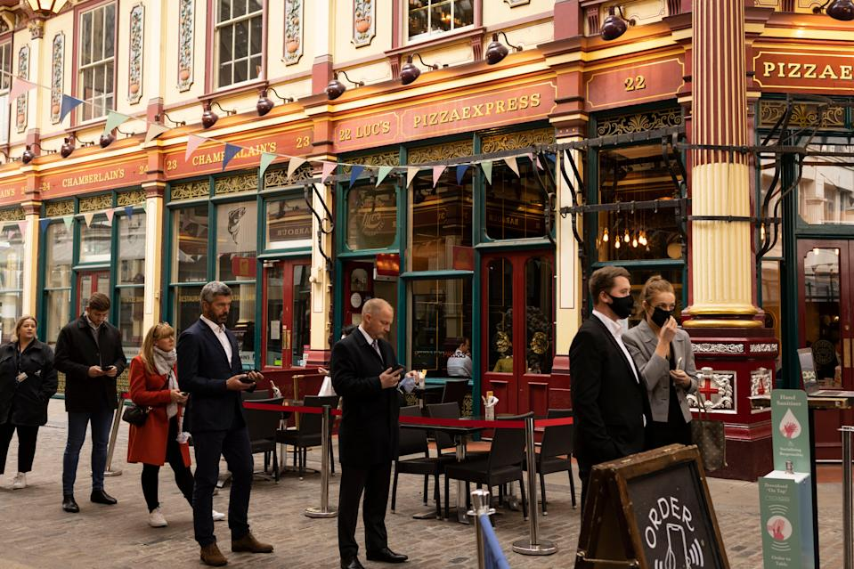 Not quite propping up the bar: the current restrictions will stay in place until July (Getty Images)