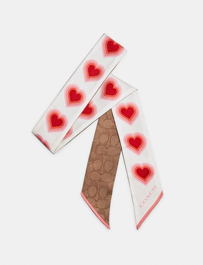 Signature 70'S Heart Print Silk Skinny Scarf. Image via Coach Outlet.