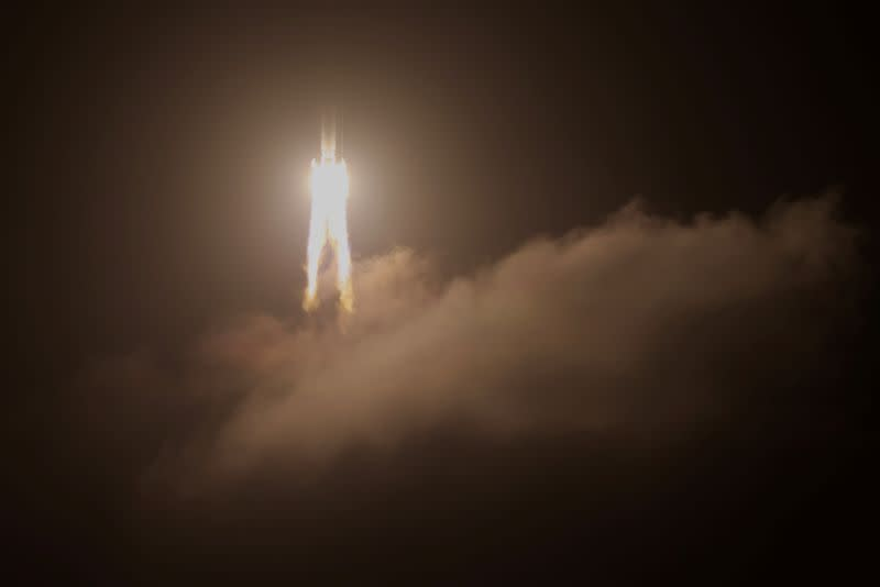 FILE PHOTO: The Long March-5 Y5 rocket, carrying the Chang'e-5 lunar probe, takes off from Wenchang Space Launch Center
