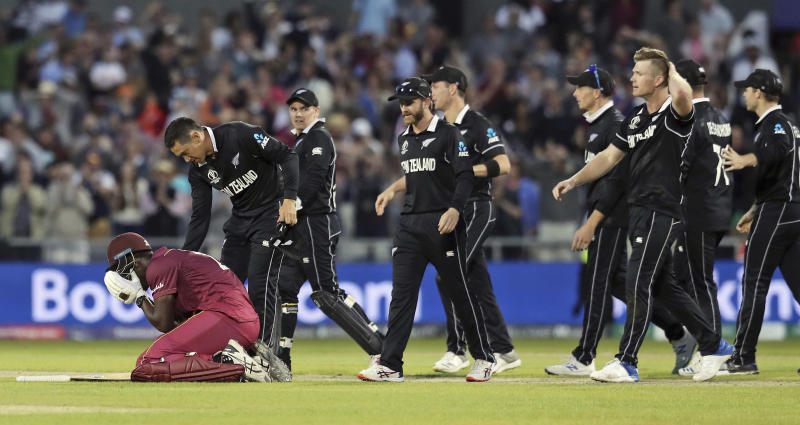 New Zealand's Ross Taylor consoles West Indies' Carlos Brathwaite at the end of the Cricket World Cup match between New Zealand and West Indies at Old Trafford in Manchester, England, Saturday, June 22, 2019. Brathwaite blazed 101 from 82 balls as the last three West Indies wickets combined for 122 runs and got within one shot of a spectacular comeback victory. He went for broke, trying to hit the last ball of the 49th over from Jimmy Neesham for six and was caught on the long-on boundary by Trent Boult. (AP Photo/Jon Super)