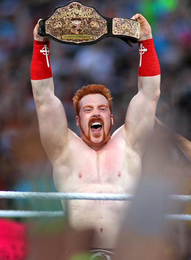 New Heavywieght Champion Sheamus celebtates at WrestleMania XXVIII in Sun Life Stadium on April 1, 2012 in Miami, Florida. (Marc Serota/AP Images)