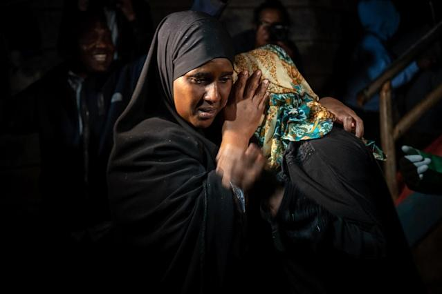 A woman is reunited with family after being evacuated from the DusitD2 compound in Nairobi (AFP Photo/Fredrik Lerneryd)