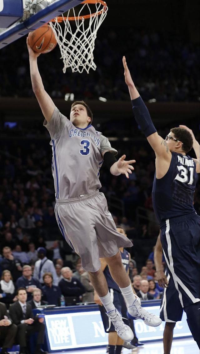 Creighton's Doug McDermott (3) drives past Xavier's Isaiah Philmore (31) during the first half of an NCAA college basketball game in the semifinals of the Big East Conference men's tournament Friday, March 14, 2014, at Madison Square Garden in New York. (AP Photo/Frank Franklin II)