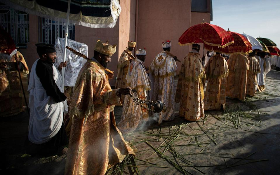 Priests from the Ethiopian Orthodox Tewahedo Church lead the procession during a Sunday morning service at the Church of St. Mary in Mekele, in the Tigray region of northern Ethiopia - Ben Curtis/AP