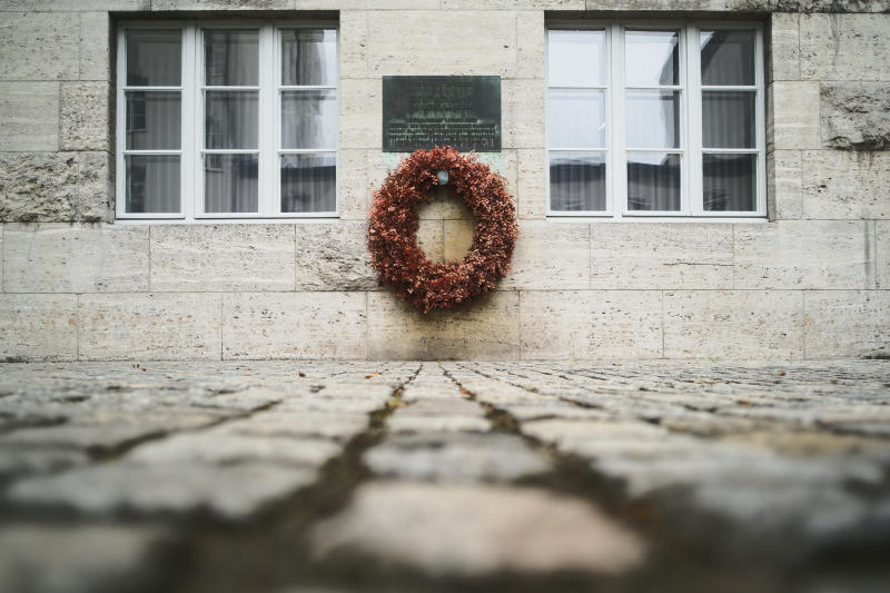 In this Friday, July 12, 2019 photo a wreath fixed under a remembrance plaque marking the place where several leaders of the failed assassinate to Adolf Hitler on July 20, 1944 was shoot dead, in the courtyard of the Bendlerblock building of the German defensive ministry, in Berlin. Germany is marking the 75th anniversary of the most famous plot to kill Adolf Hitler. (AP Photo/Markus Schreiber)
