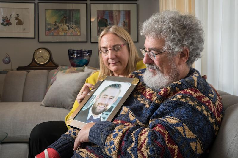 Mary Rich and her husband, Joel Rich hold a photo of their son, Seth, in their home in Omaha, Nebraska in 2017. (Photo: Matt Miller for The Washington Post via Getty Images)