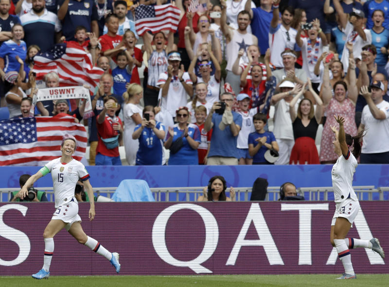 United States' Megan Rapinoe, left, celebrates with United States' Alex Morgan, right, after scoring her side's opening goal during the Women's World Cup final soccer match between US and The Netherlands at the Stade de Lyon in Decines, outside Lyon, France, Sunday, July 7, 2019. (AP Photo/Alessandra Tarantino)