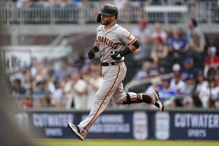 San Francisco Giants' Tommy La Stella rounds the bases after hitting a home run during the first inning of the team's baseball game against the Atlanta Braves on Saturday, Aug. 28, 2021, in Atlanta. (AP Photo/John Bazemore)