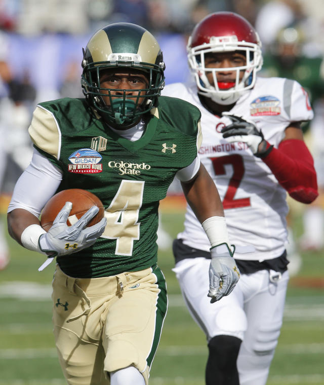 Colorado State wide receiver Charles Lovett (4) runs in a touchdown after the reception as Washington State cornerback Nolan Washington (2) defends during the first half of the New Mexico Bowl NCAA college football game, Saturday, Dec. 21, 2013, in Albuquerque, N.M. (AP Photo/Matt York)