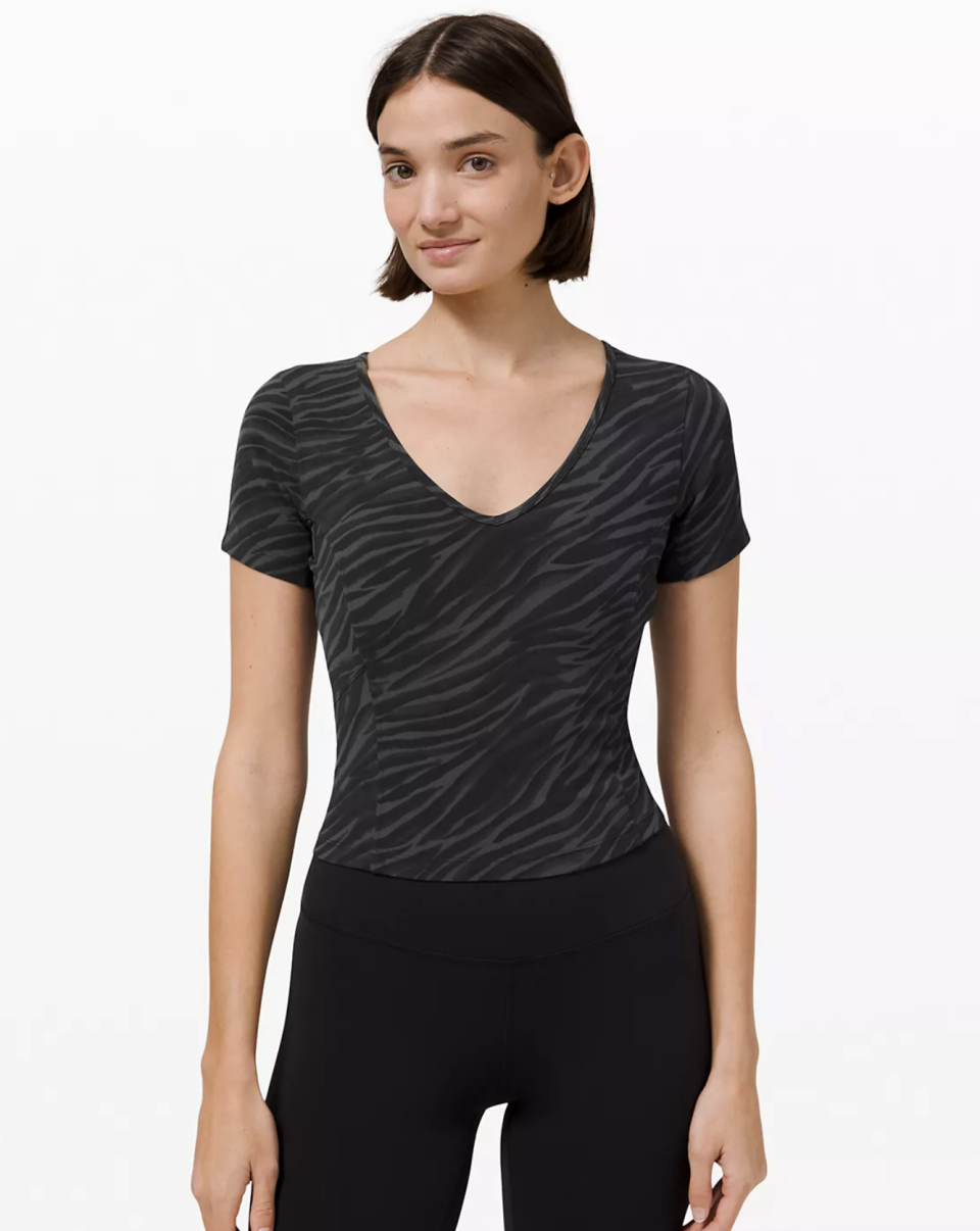 """<p><strong>Lululemon</strong></p><p>lululemon.com</p><p><a href=""""https://go.redirectingat.com?id=74968X1596630&url=https%3A%2F%2Fshop.lululemon.com%2Fp%2Ftops-short-sleeve%2FNulu-Cropped-Slim-Yoga-Short-Sleeve-MD%2F_%2Fprod10480076&sref=https%3A%2F%2Fwww.seventeen.com%2Ffashion%2Fg30519407%2Fdoes-lululemon-have-sales%2F"""" rel=""""nofollow noopener"""" target=""""_blank"""" data-ylk=""""slk:Shop Now"""" class=""""link rapid-noclick-resp"""">Shop Now</a></p><p><strong><strong><del>$68</del> $49 (34% off)</strong></strong></p><p>Made of butter-soft Nulu fabric, this lil crop is *literally* the crop top version of your favorite Align Leggings.</p>"""
