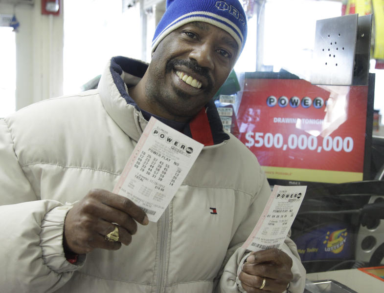 Lamar Fallie, 52, of Chicago buys six Powerball tickets at a BP gas station Wednesday, Nov. 28, 2012 in Calumet Park, Ill. Fallie who is currently unemployed say he doesn't normally play the lottery but was lured by tonight's 500 million dollar jackpot. If he wins he says he will take care of his church first, then every child Beasley Elementary School will get a laptop, he will make a donation to Julian High School then he will retire from being unemployed. (AP Photo/M. Spencer Green)