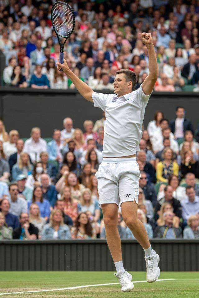The crowd applauds as Hubert Hurkacz celebrates his Men's Singles fourth round victory over Daniil Medvedev on Centre Court