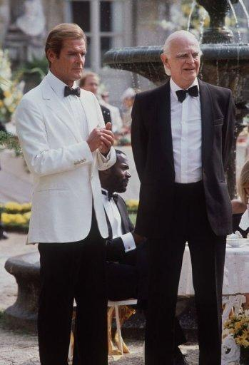 """Actors Roger Moore (L) and Willoughby Gray stand together on the set of the 14th James Bond film """"A View to a Kill"""" in Chantilly, France in 1984. Bond fans on Friday celebrated 50 years of the suave British spy's adventures on the silver screen with a day of 007-themed events around the world"""
