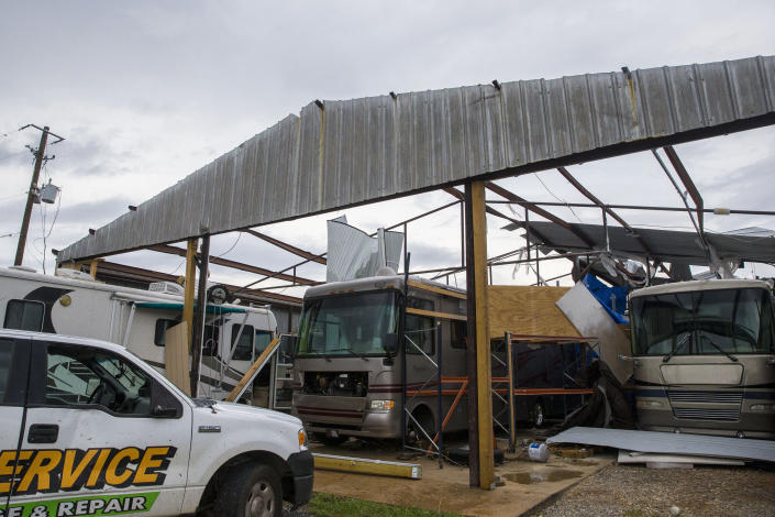 AMU RV service and repair on Old Greensboro Road where severe weather destroyed multiple client-owned recreational vehicles and tore the roof off the workshop with people inside, who survived, Wednesday, March 17, 2021, in Moundville, Ala. Possible tornadoes knocked down trees, toppled power lines and damaged homes in rural Chilton County and the Alabama communities of Burnsville and Moundville, where power was out and trees blocked a main highway. (AP Photo/Vasha Hunt)