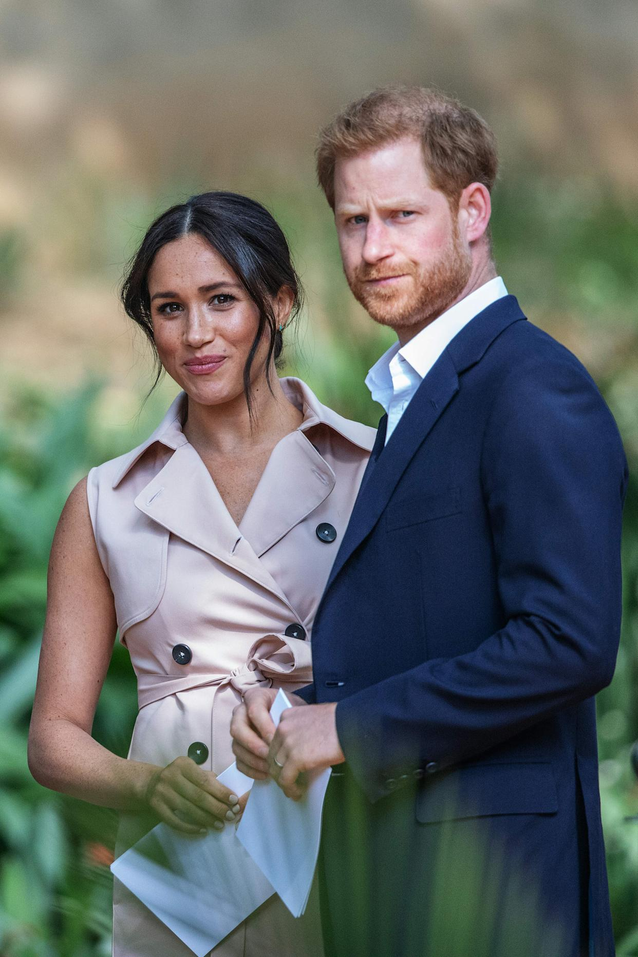 Britain's Prince Harry, Duke of Sussex(R) and Meghan, the Duchess of Sussex(L) arrive at the British High Commissioner residency in Johannesburg where they  will meet with Graca Machel, widow of former South African president Nelson Mandela, in Johannesburg, on October 2, 2019. - Prince Harry recalled the hounding of his late mother Diana to denounce media treatment of his wife Meghan Markle, as the couple launched legal action against a British tabloid for invasion of privacy. (Photo by Michele Spatari / AFP) (Photo by MICHELE SPATARI/AFP via Getty Images)