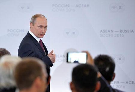 Russian President Putin gestures as he arrives for meeting with businessmen on sidelines of Russia-ASEAN summit in Sochi