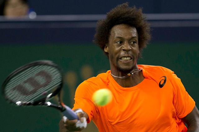 France's Gael Monfils returns a shot to Serbia's Novak Djokovic during the singles quarterfinal match at the Shanghai Masters tennis tournament at the Qizhong Forest Sports City Tennis Center in Shanghai, China on Friday, Oct. 11, 2013. Djokovic won 6-7, 6-2, 6-4. (AP Photo/Ng Han Guan)