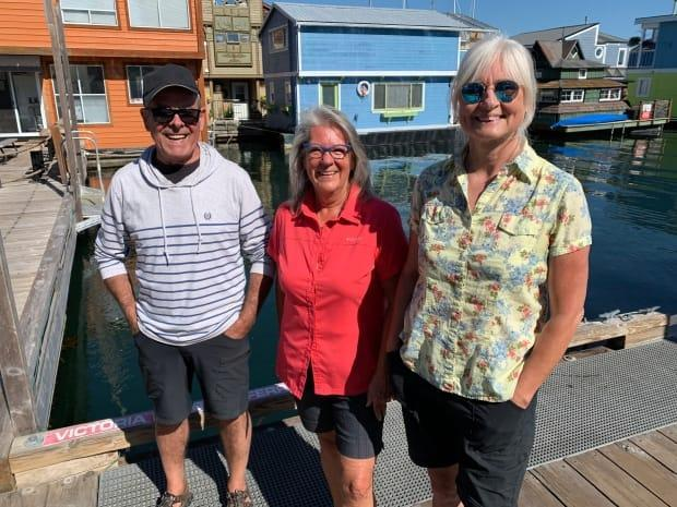 Gerry L'Esperance, left, Melanie Sibbitt, centre, and Kim Young say they hope to talk with the Greater Victoria Harbour Authority about keeping the docks they live on at Fisherman's Wharf closed to public access. (Adam van der Zwan/CBC - image credit)