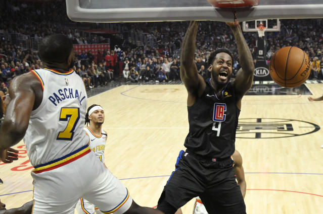 Los Angeles Clippers forward JaMychal Green, right, dunks as Golden State Warriors forward Eric Paschall defends during the second half of an NBA basketball game Friday, Jan. 10, 2020, in Los Angeles. The Clippers won 109-100. (AP Photo/Mark J. Terrill)