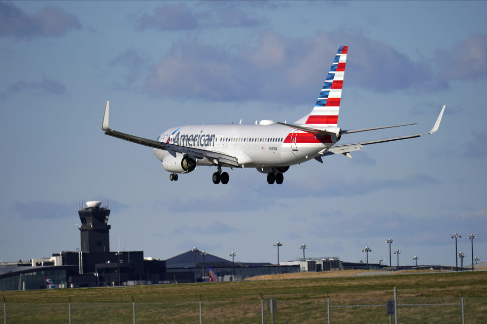 An American Airlines flight from Dallas-Fort Worth International Airport makes its landing approach onto Baltimore-Washington International Thurgood Marshall Airport, Monday, Nov. 23, 2020, in Glen Burnie, Md. (AP Photo/Julio Cortez)