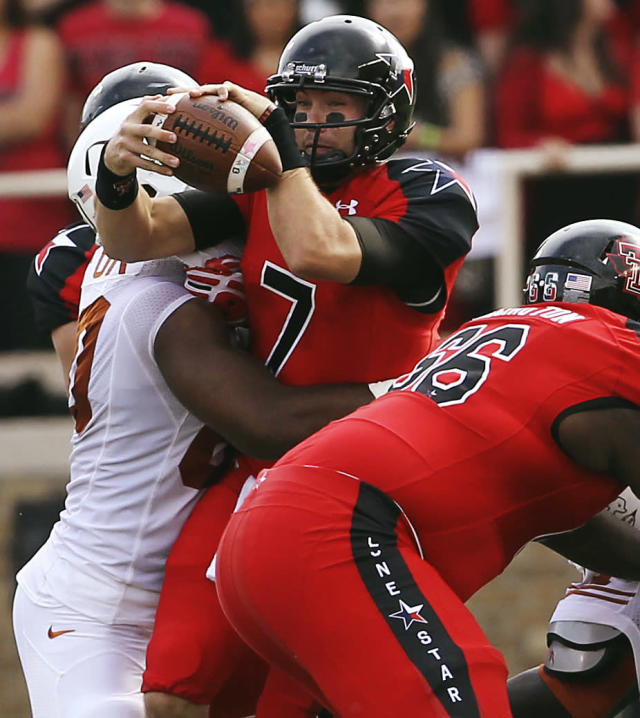 Texas Tech's Seth Doege is hit by Texas' Alex Okafor ahead of Texas Tech's Deveric Gallington (66) during their NCAA college football game, Saturday, Nov. 3, 2012, in Lubbock, Texas. (AP Photo/Lubbock Avalanche-Journal,Stephen Spillman) LOCAL TV OUT