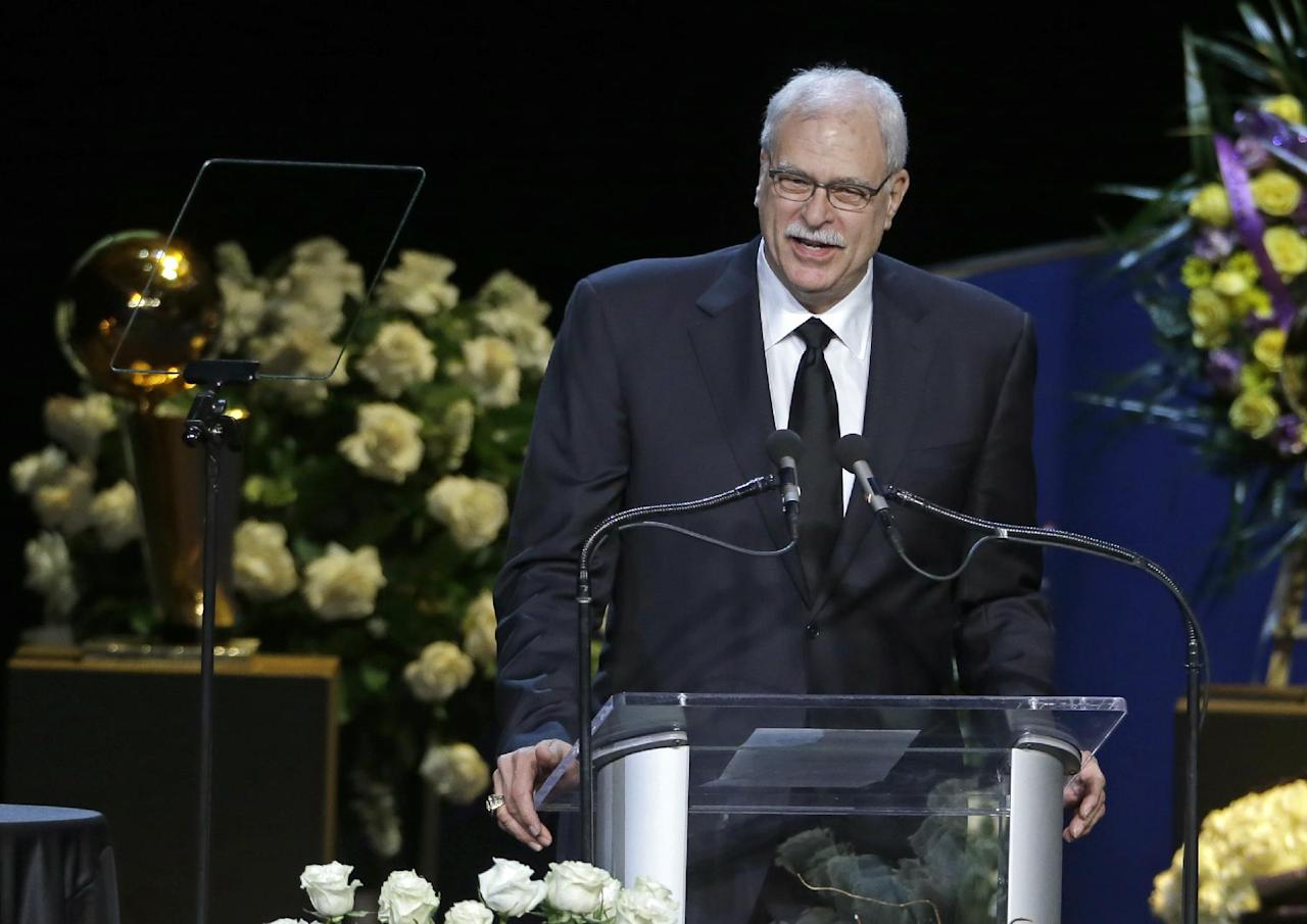 Former Los Angeles Lakers head coach Phil Jackson during a memorial service for Jerry Buss, the late Lakers owner who died Monday from cancer complications, Thursday, Feb. 21, 2013, in Los Angeles. (AP Photo/Reed Saxon)