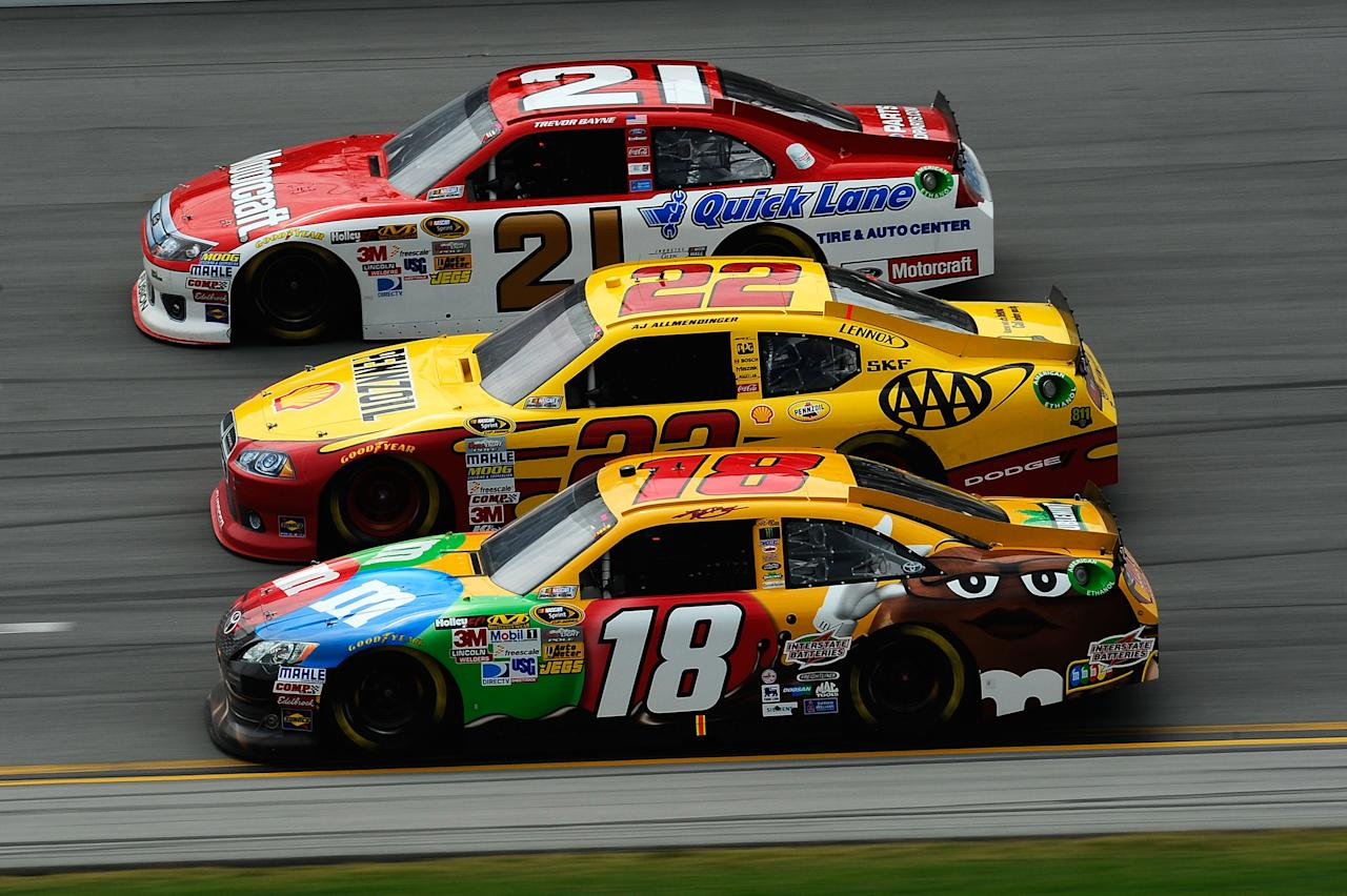 TALLADEGA, AL - MAY 06:  Kyle Busch, driver of the #18 M&M's Toyota, AJ Allmendinger, driver of the #22 Shell/Pennzoil-AAA Dodge, and Trevor Bayne, driver of the #21 Motorcraft/Quick Lane Tire & Auto Center Ford, race during the NASCAR Sprint Cup Series Aaron's 499 at Talladega Superspeedway on May 6, 2012 in Talladega, Alabama.  (Photo by Jared C. Tilton/Getty Images)