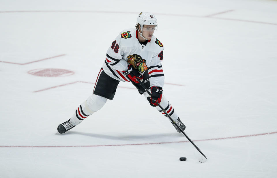 Chicago Blackhawks defenseman Lucas Carlsson (46) looks to pass during the first period of an NHL hockey game against the Dallas Stars, Sunday, Feb. 23, 2020, in Dallas. (AP Photo/Brandon Wade)