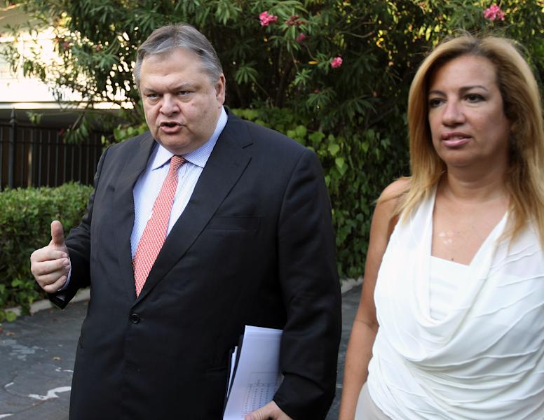 Greece's socialists leader of PASOK Evangelos Venizelos leaves with his party's spokeswoman Fofi Gennimata Maximos mansion after a meeting with Prime Minister Antonis Samaras in Athens, Wednesday, Aug. 1, 2012. A junior partner in Greece's fragile coalition government has dropped objections to new spending cuts demanded by the debt-crippled country's bailout creditors. (AP Photo/Thanassis Stavrakis)