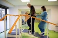 Yannis Ieremias who suffered from COVID-19 attends physiotherapy at the Theseus Rehabilitation Centre in Athens