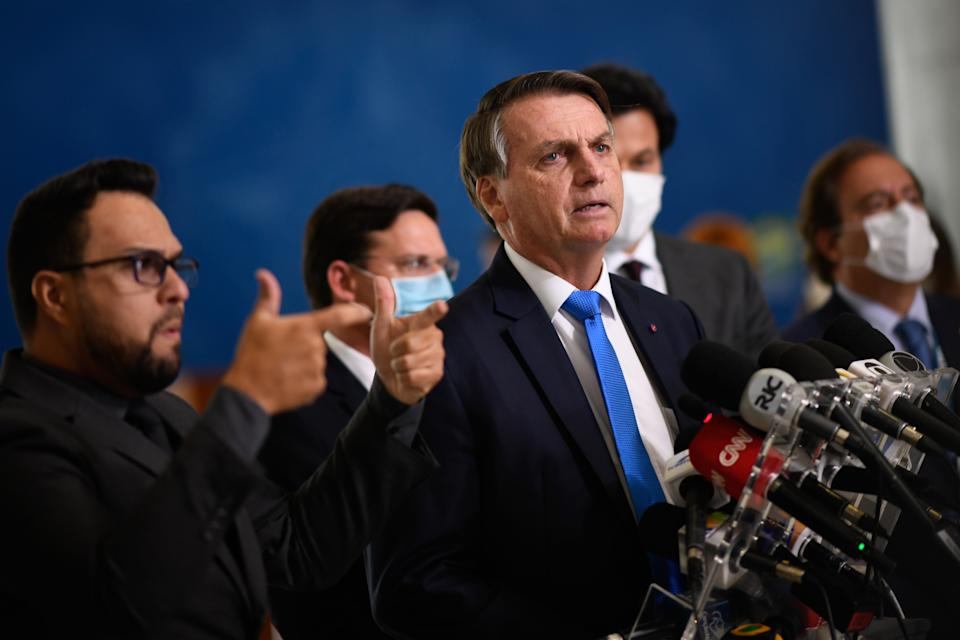 BRASILIA, BRAZIL - MARCH 31: President of Brazil Jair Bolsonaro speaks to the press during a pronouncement on the new emergency aid amidst the coronavirus pandemic(COVID-19) at the Planalto Palace, on March 31,2021 in Brasilia, Brazil. Brazil has over 12,658,000 confirmed positive cases of Coronavirus and has over 317,646 deaths. (Photo by Mateus Bononi/Getty Images)