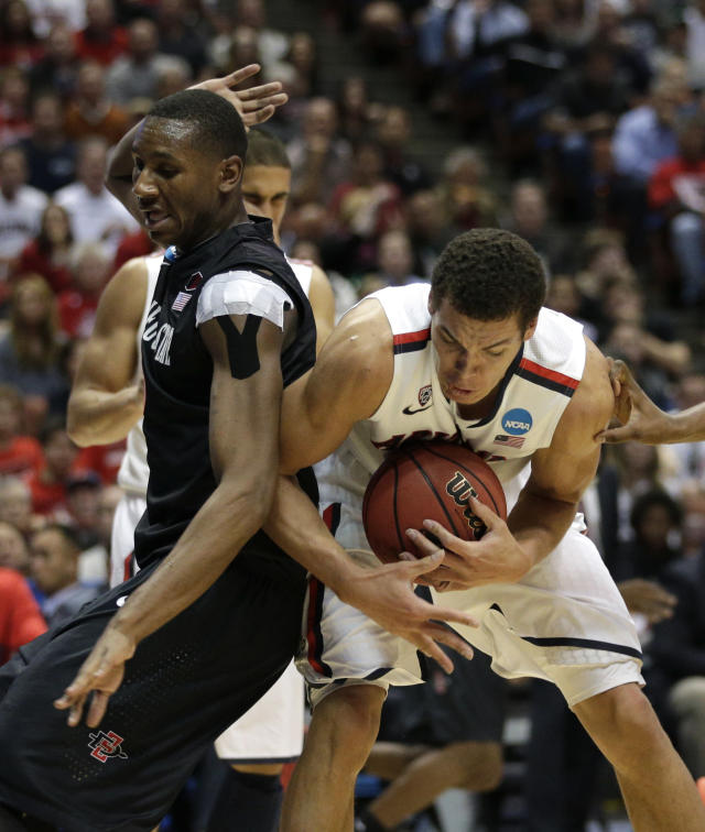 San Diego State forward Skylar Spencer, left, defends as Arizona forward Aaron Gordon grabs the ball during the first half of an NCAA men's college basketball tournament regional semifinal, Thursday, March 27, 2014, in Anaheim, Calif. (AP Photo/Jae C. Hong)