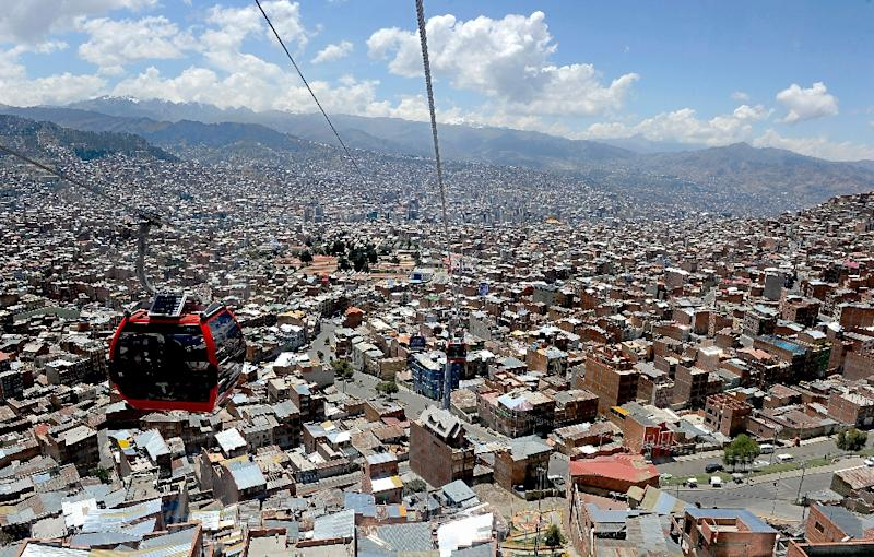 A cable-car travels over La Paz, on October 10, 2014
